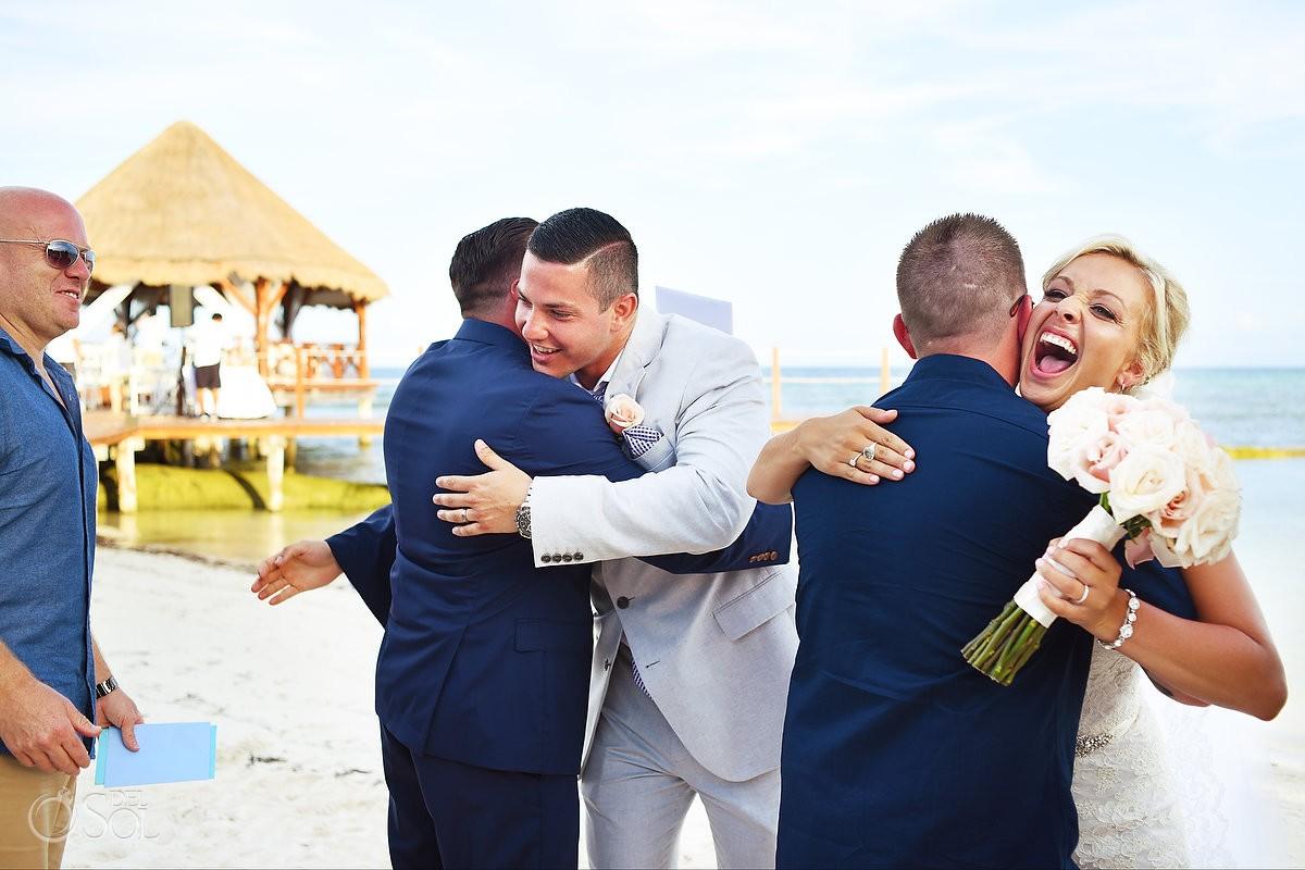 celebration hugs Destination Wedding Secrets Silversands Riviera Cancun, Mexico