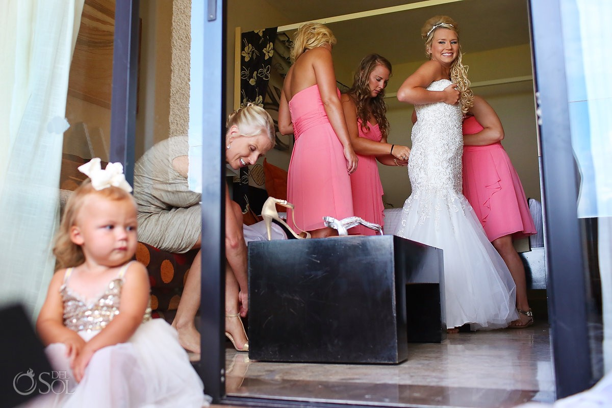 Bride getting dressed Allure bridals wedding dress cute flower girl watching Dreams Puerto Aventuras, Riviera Maya, Mexico