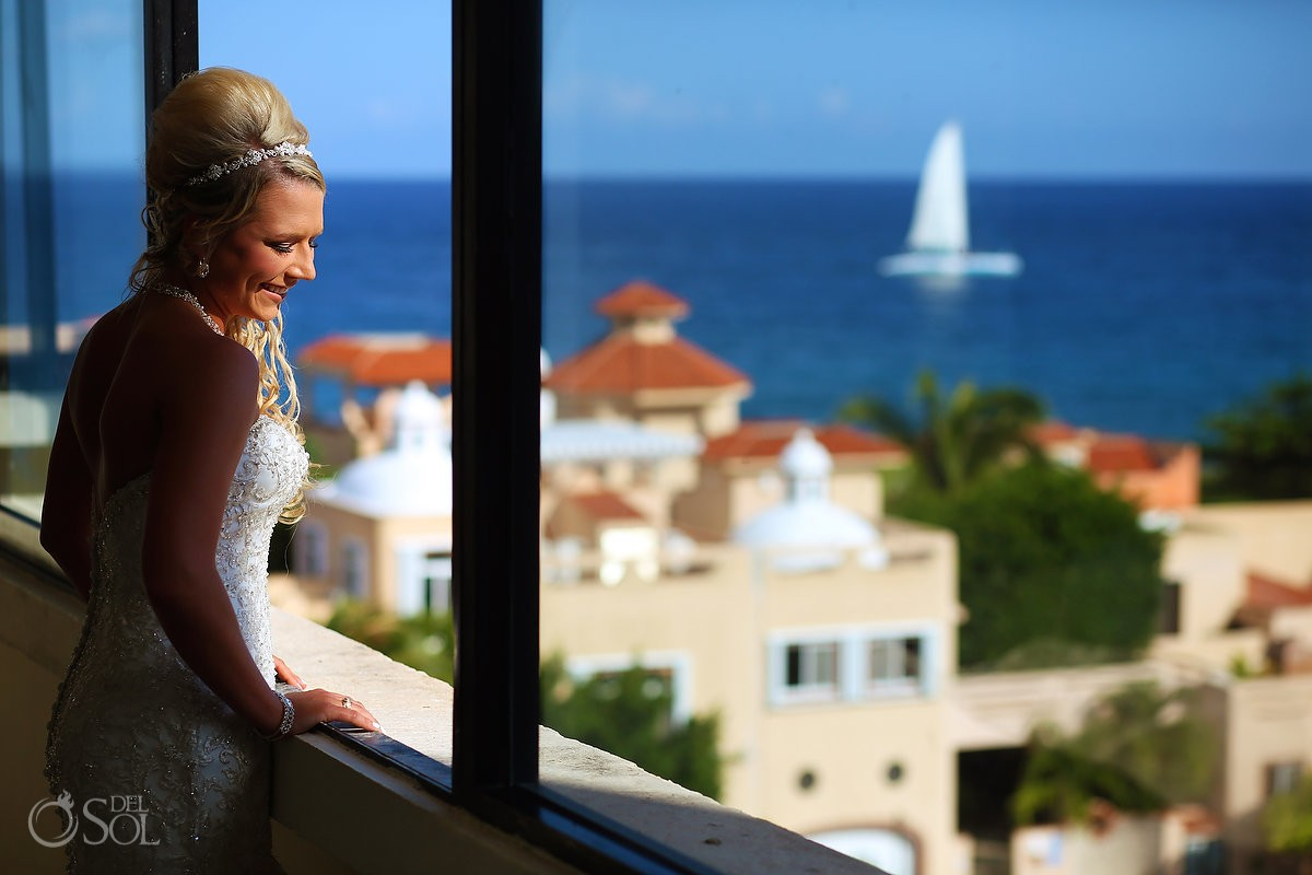 candid bride portrait overlooking Caribbean ocean view sailboat passing Dreams Puerto Aventuras, Riviera Maya, Mexico