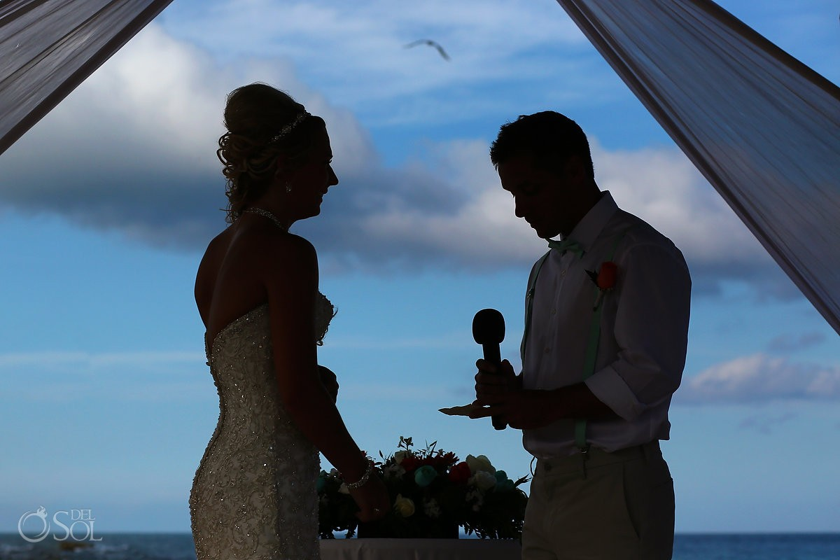 silhouette groom reading vows bird flying overhead Dreams Puerto Aventuras Gazebo Wedding Riviera Maya, Mexico