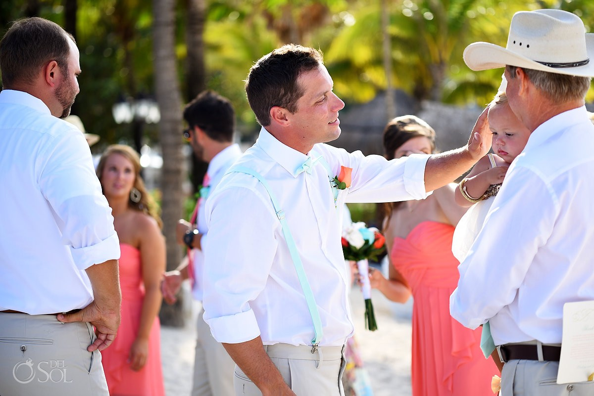 groom and baby daughter family love celebration Dreams Puerto Aventuras Gazebo Wedding Riviera Maya, Mexico