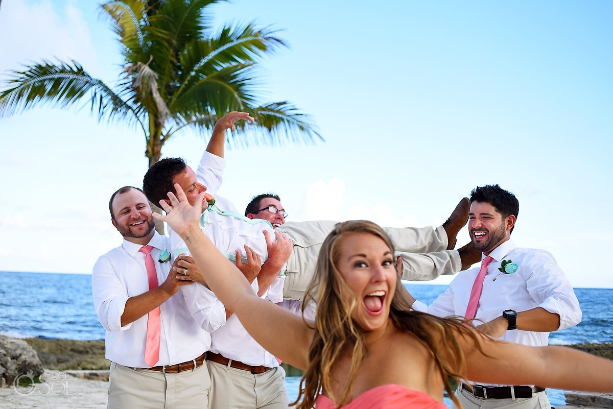 bridesmaid photobombs groomsman formal portrait funny destination wedding picture Dreams Puerto Aventuras