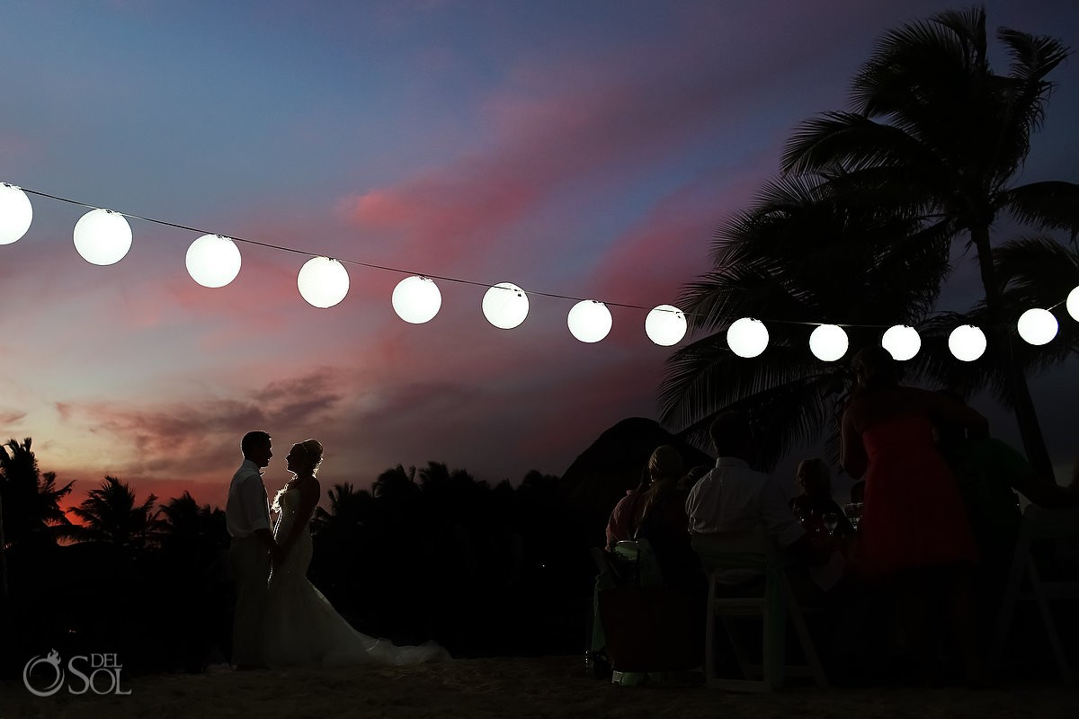 Sunset silhouette portrait paper lanterns destination wedding reception Dreams Puerto Aventuras North Beach