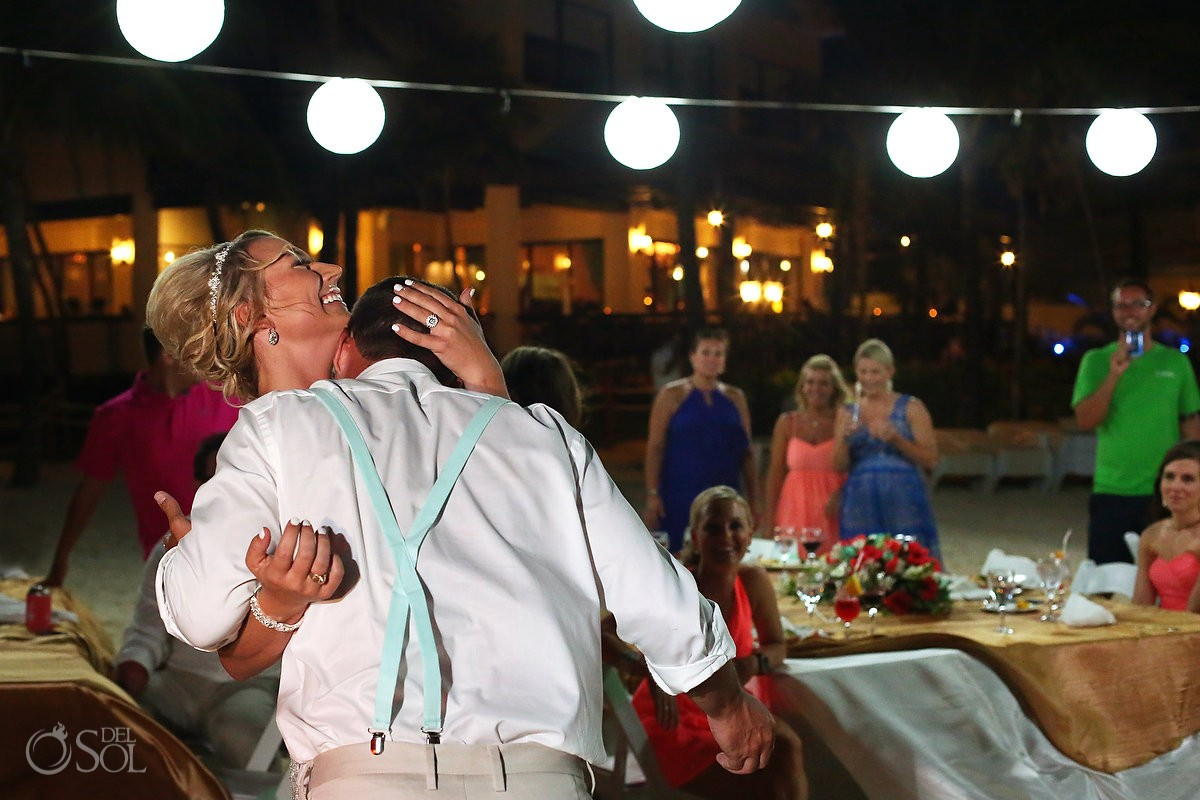 groom licking cake off bride's chest destination wedding reception Dreams Puerto Aventuras North Beach