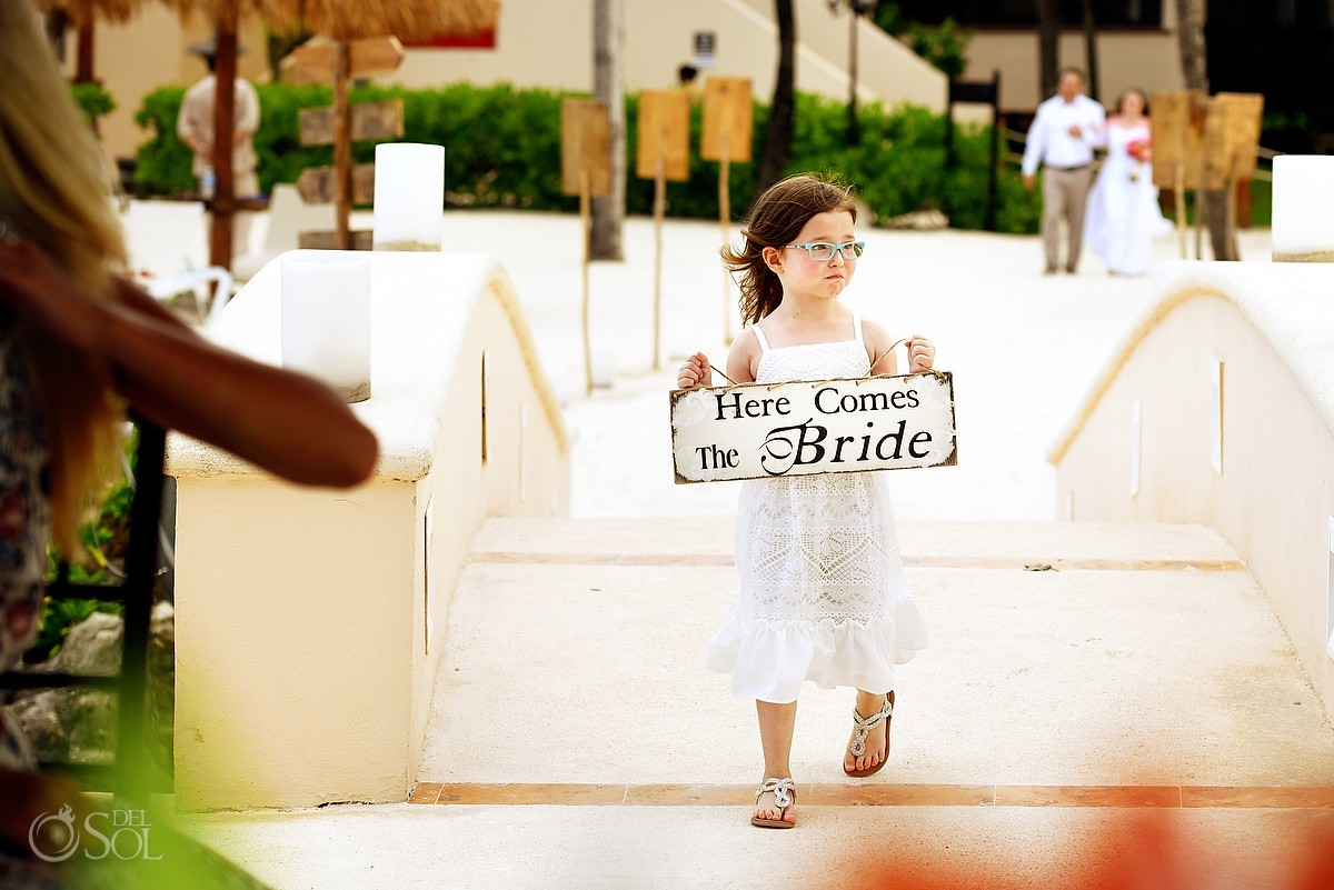 processional flower girl holding here comes the bride sign, Dreams Puerto Aventuras gazebo, Riviera Maya, Mexico