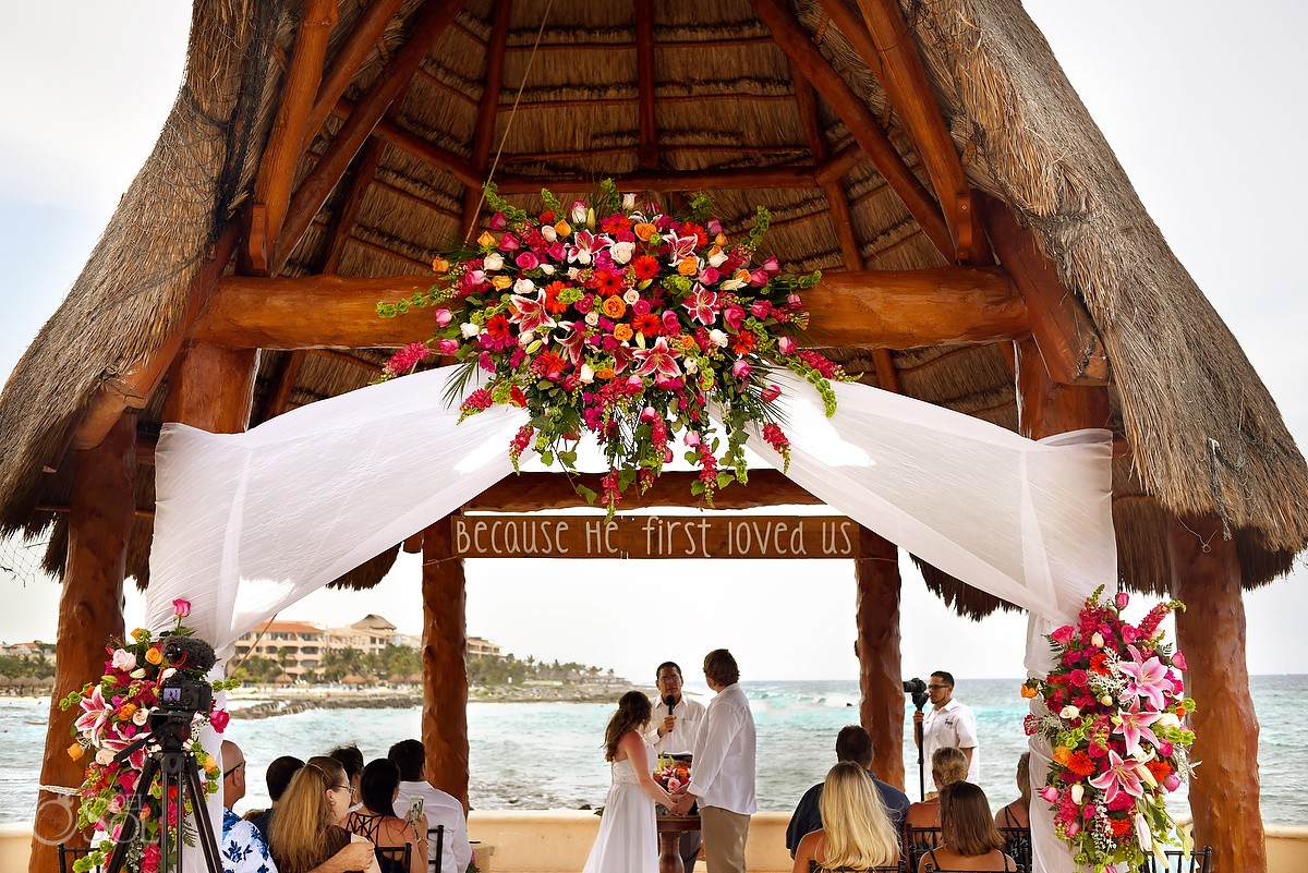 because he first loved us sign, colourful red pink floral decoration gazebo ceremony, Dreams Puerto Aventuras