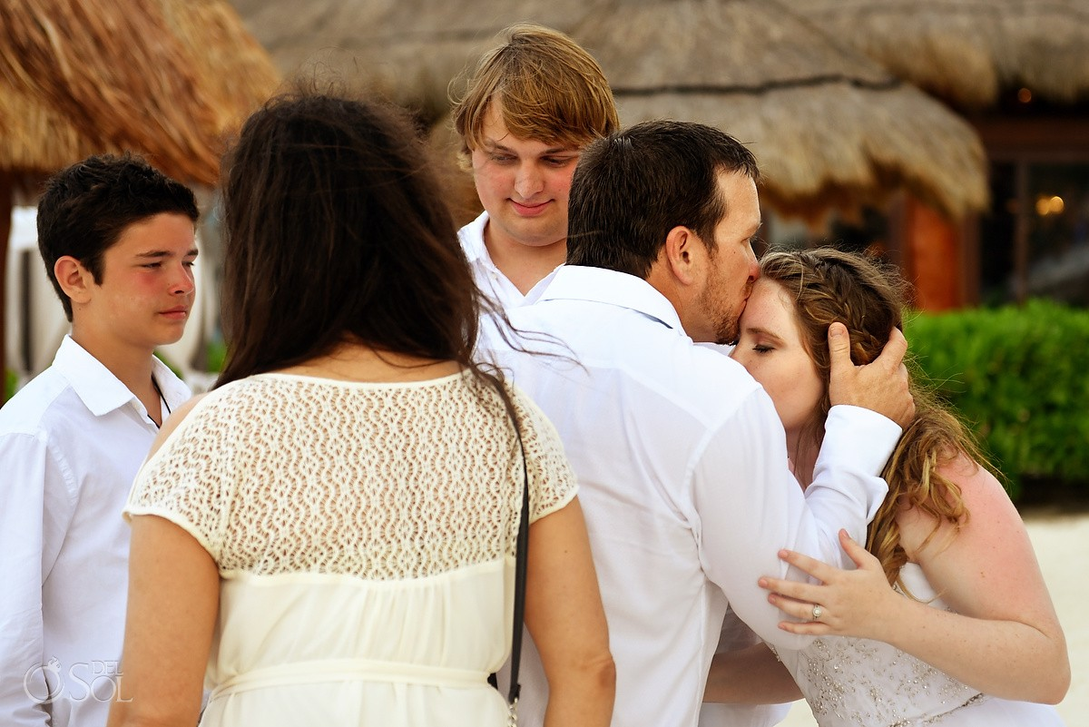 Family love wedding celebration hugs, wedding guests Dreams Puerto Aventuras, Riviera Maya