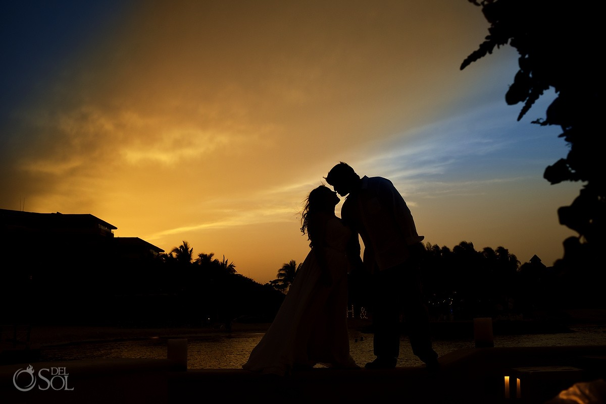 Romantic sunset beach wedding portrait silhouette Dreams Puerto Aventuras, Mexico