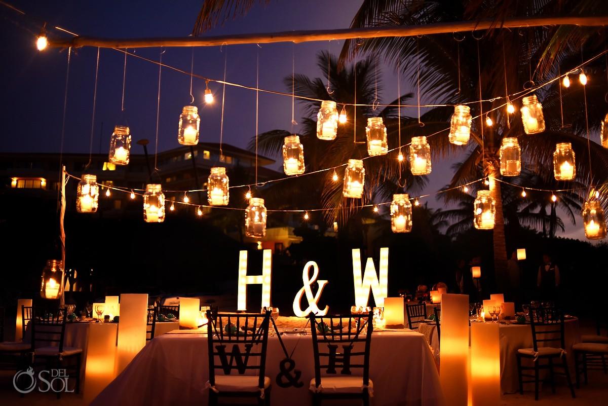 bohemian mason jar hanging candles tea lights wedding reception decor idea by Candle Boutique Dreams Puerto Aventuras