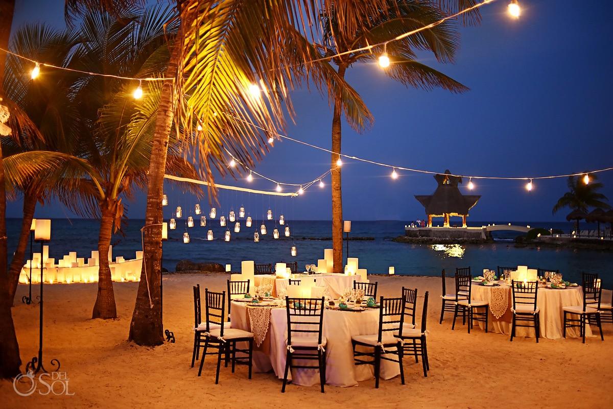 Romantic candle lit destination wedding reception set up Dreams Puerto Aventuras Riviera Maya Mexico