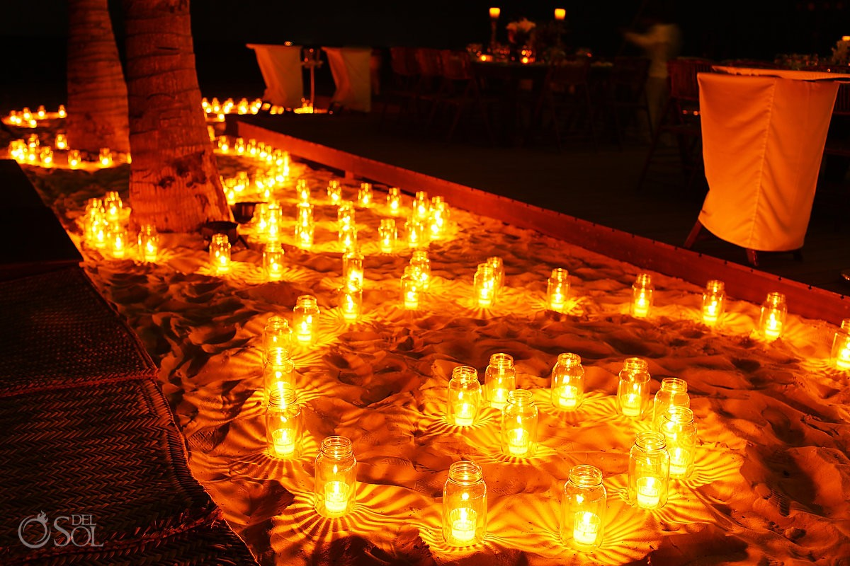 wedding reception decoration idea, candles in Mason jar spirals, installation by the Candle Boutique