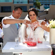 Bride and groom pour unity ceremony idea cocktail destination beach wedding Hard Rock Hotel Cancun