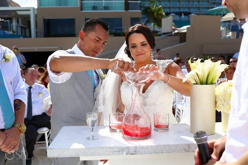 Bride and groom pour unity cocktail destination beach wedding Hard Rock Hotel Cancun