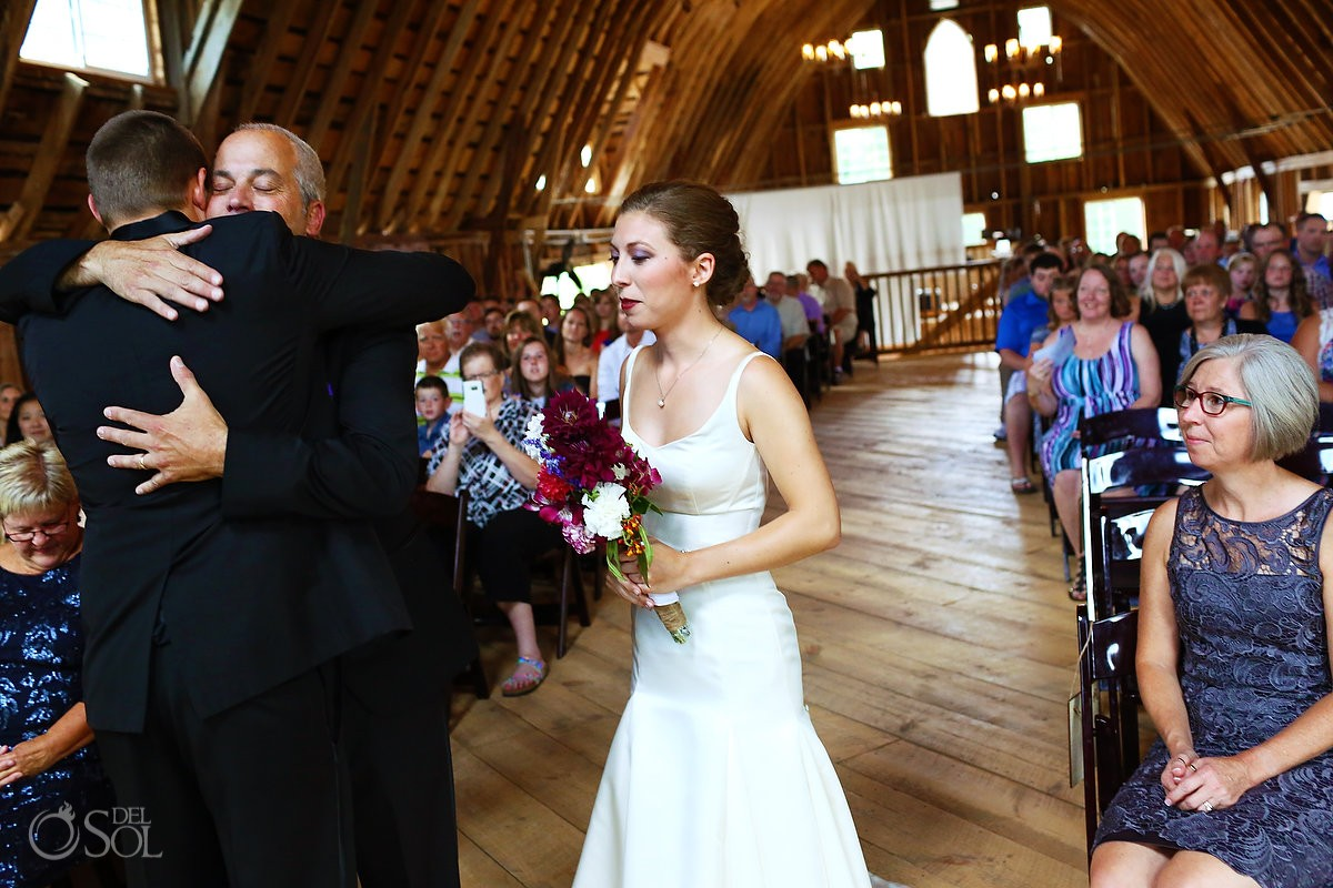 father of the bride hugging wedding ceremony bloom lake barn