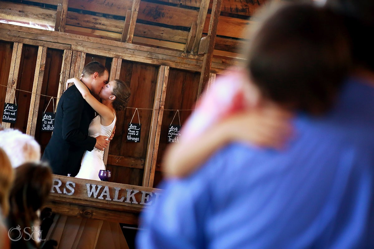 bloom lake barn wedding kiss