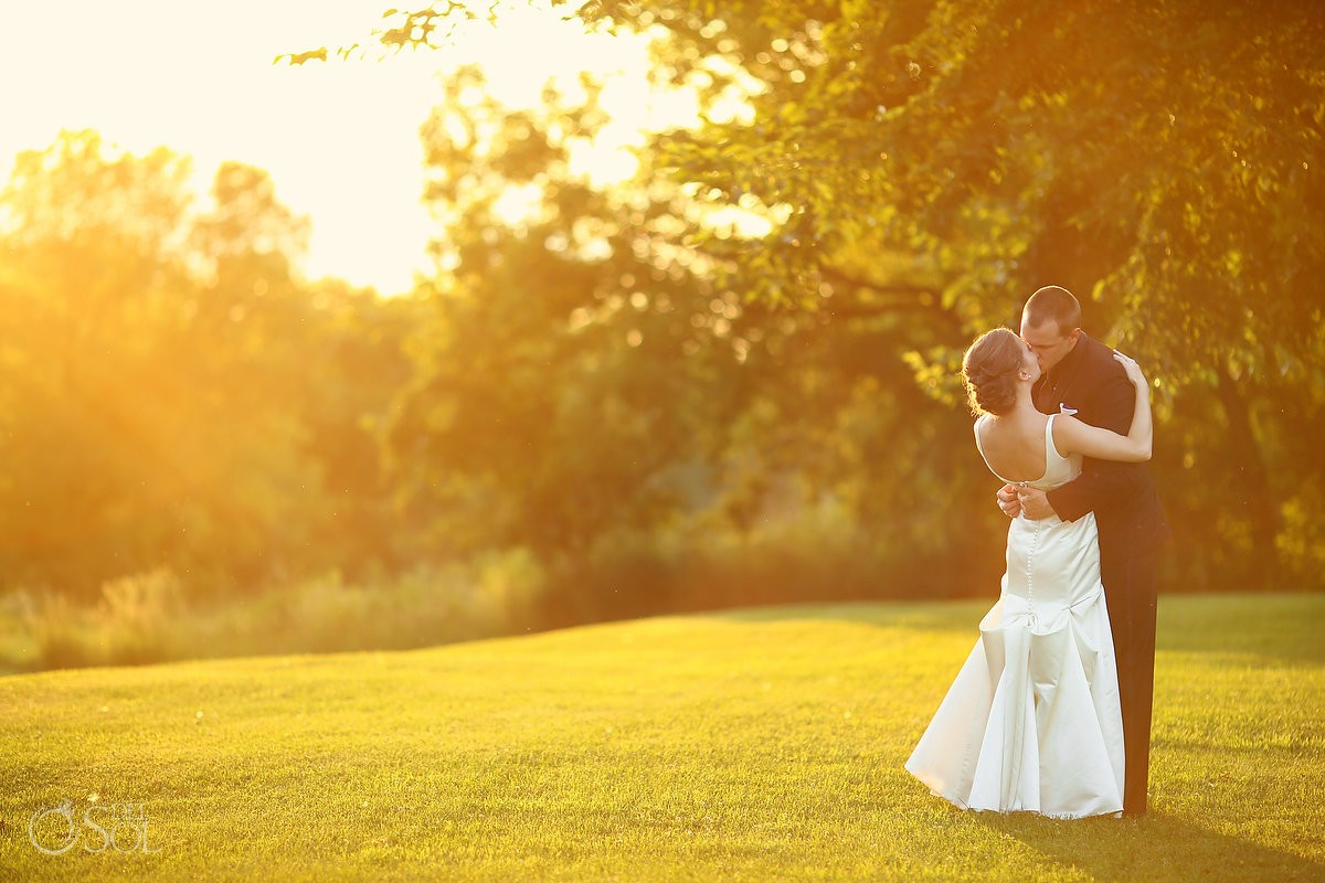 bride and groom at sunset bloom lake barn wedding
