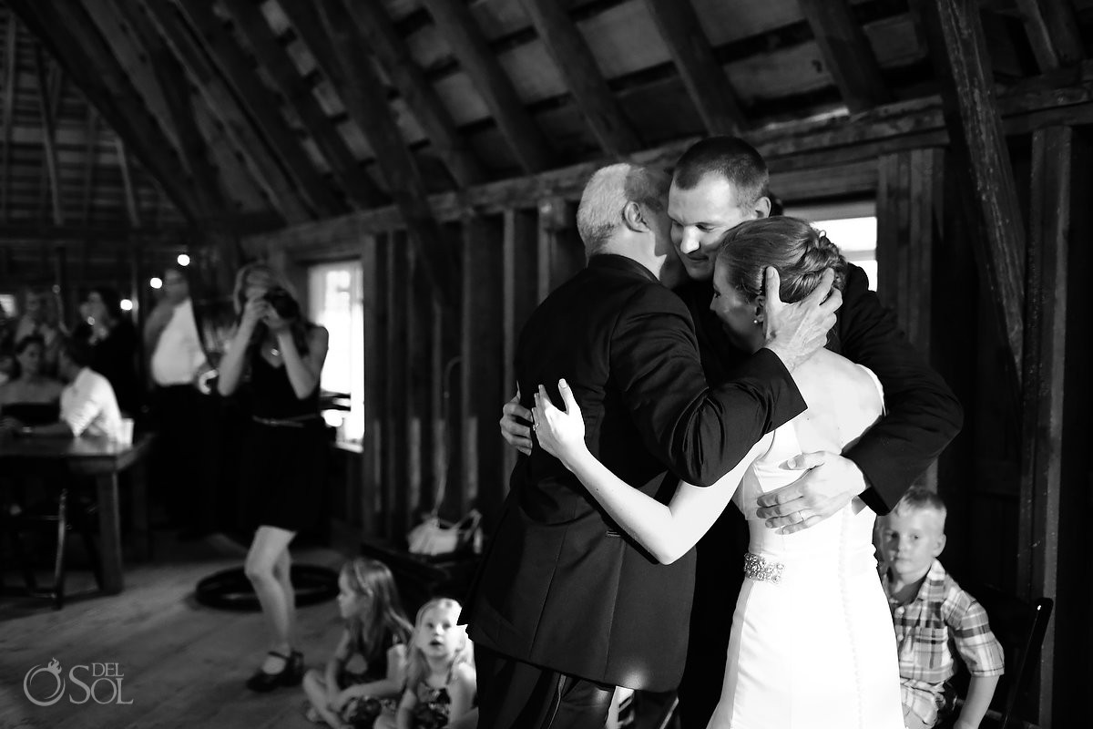 reception dance hug bloom lake barn wedding