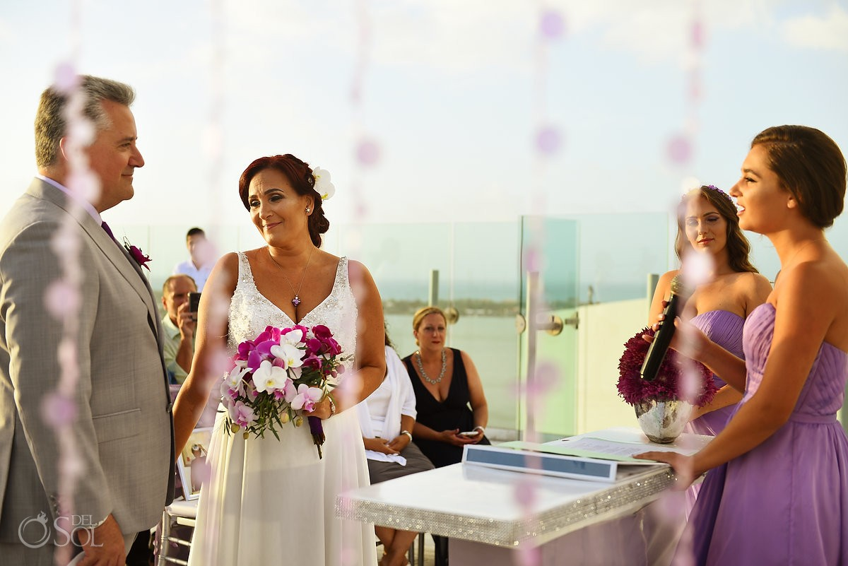 daughter singing wedding ceremony, Beach Palace, Cancun, Mexico.