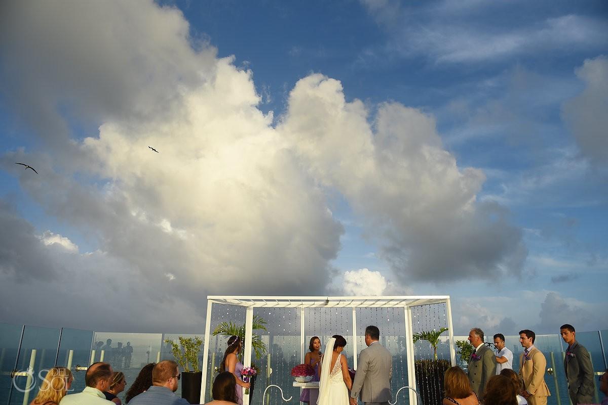 Beautiful sky terrace destination wedding ceremony Beach Palace, Cancun, Mexico.