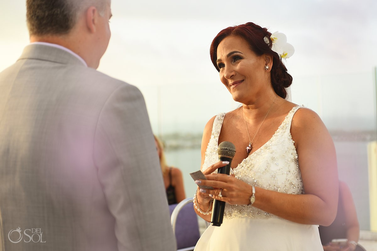 wedding vows, sunset ceremony, Beach Palace, Cancun, Mexico.