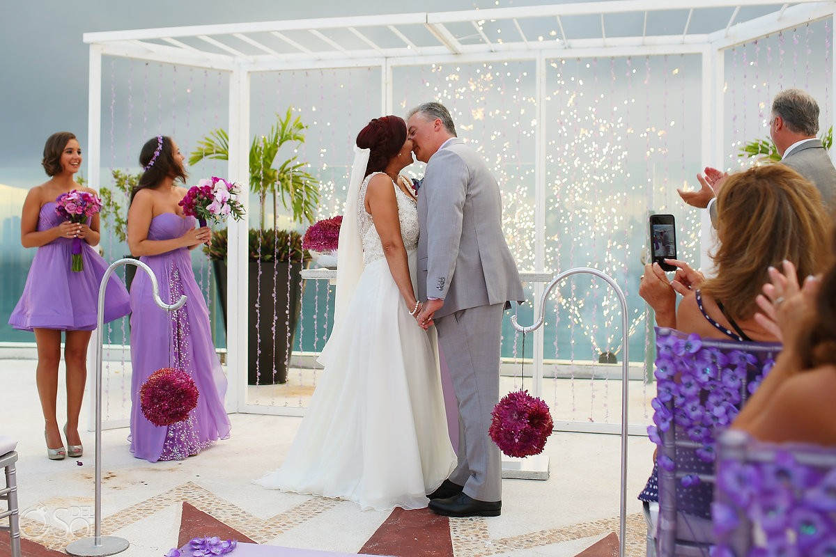 first kiss sky terrace wedding ceremony Beach Palace, Cancun, Mexico.