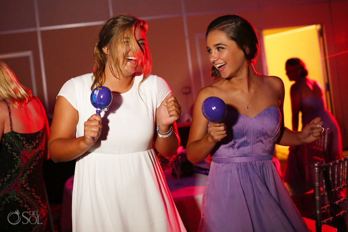 fun party moment, playing maracas, wedding reception Beach Palace, Cancun, Mexico.