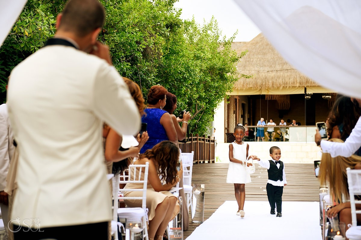 cute ring bearer wearing tuxedo and flower girl entrance Gabi bridge wedding ceremony, Playa del Carmen