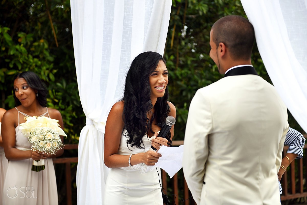 bride laughing reading wedding vows Paradisus la Perla Playa del Carmen, Mexico