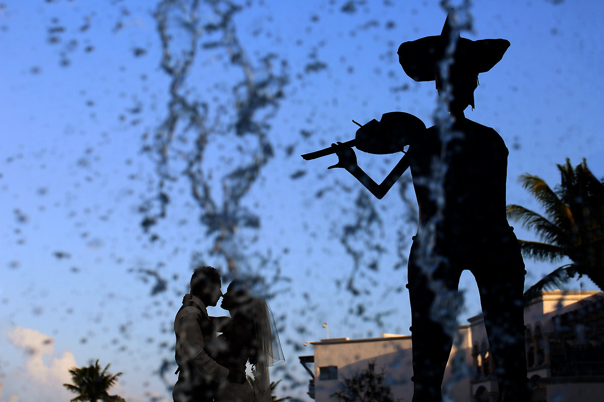Artistic silhouette bride and groom mariachi statue Royal Playa del Carmen Mexico