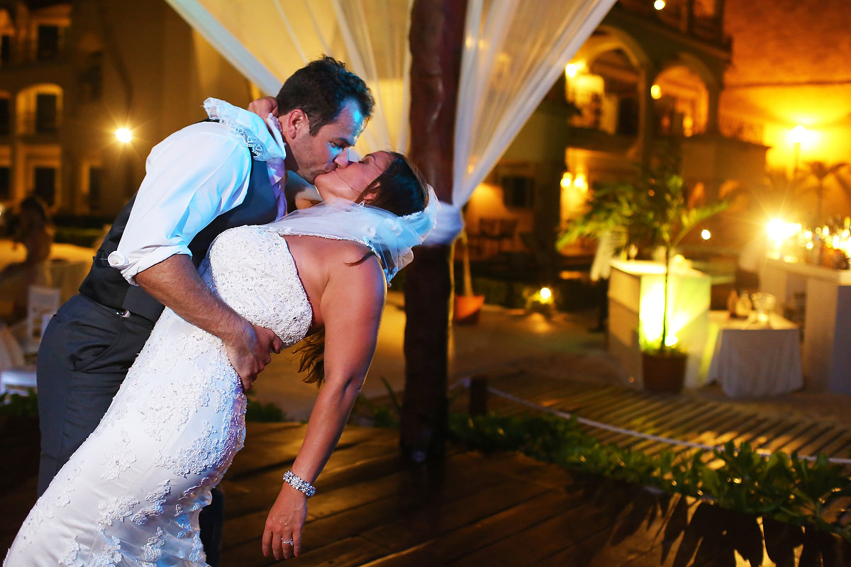 kiss bride groom wedding reception wedding Royal Playa del Carmen Mexico