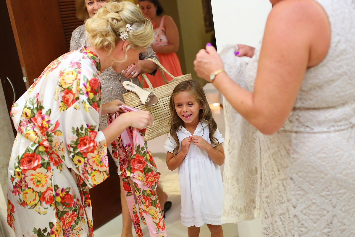 cute flower girl bride getting ready destination wedding Grand Velas Resort, Playa del Carmen, Mexico