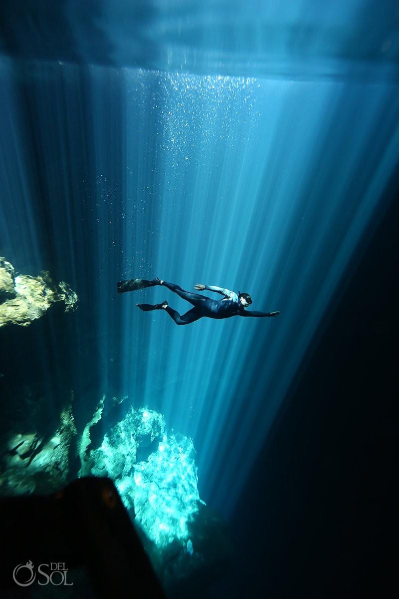 epic light rays pit cenote riviera maya mexico