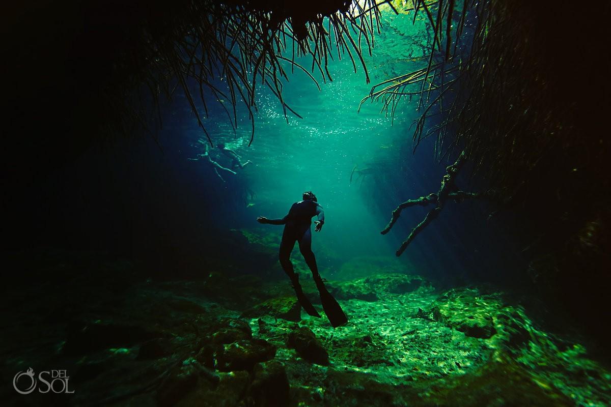 casa cenote suspended free diver riviera maya mexico