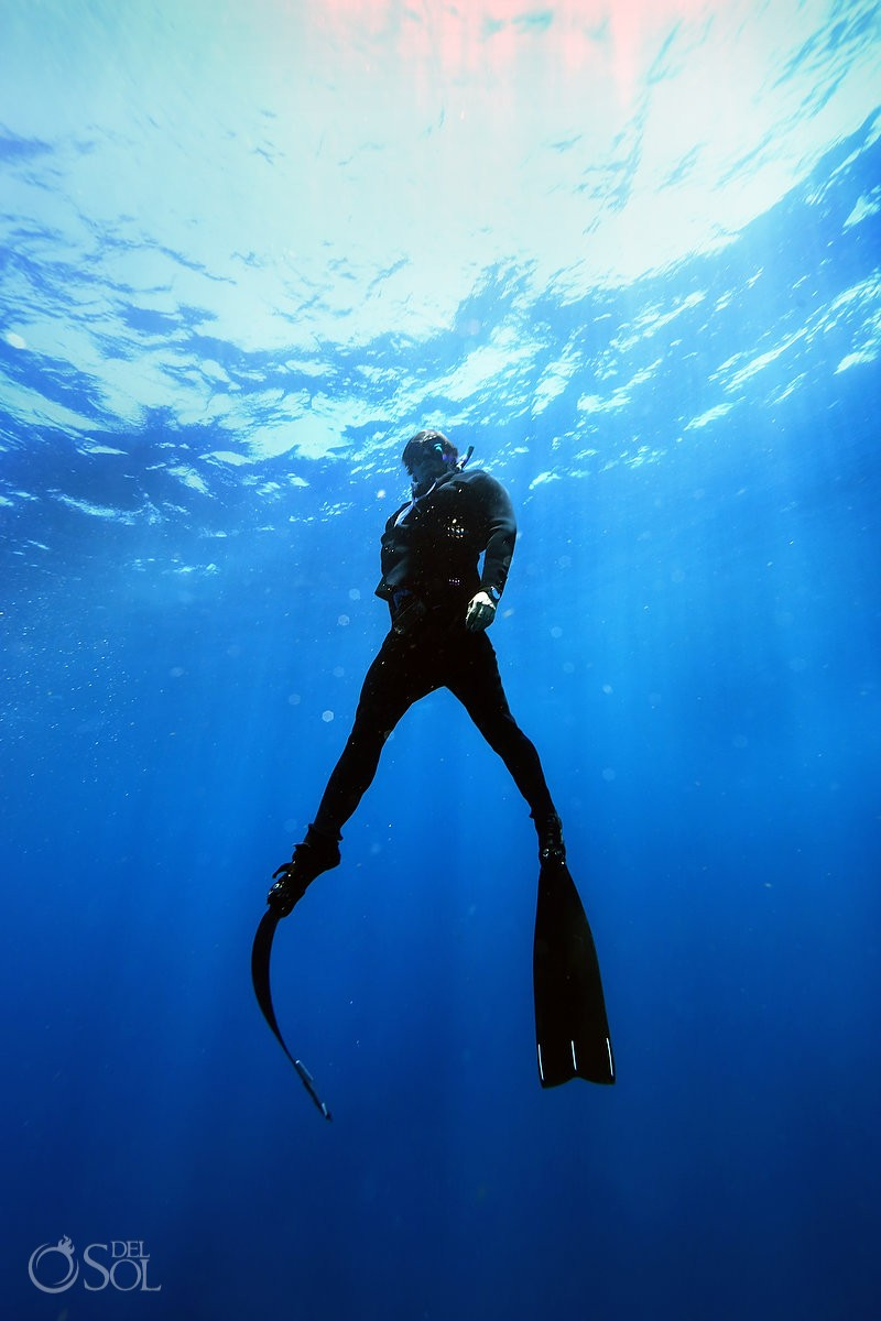freediver swimming wearing true wet suit by Oceaner