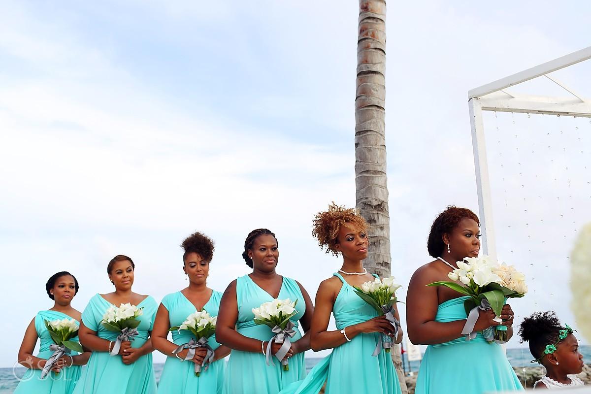 Bridesmaids wearing sea green teal dresses Beach wedding Hard Rock Riviera Maya