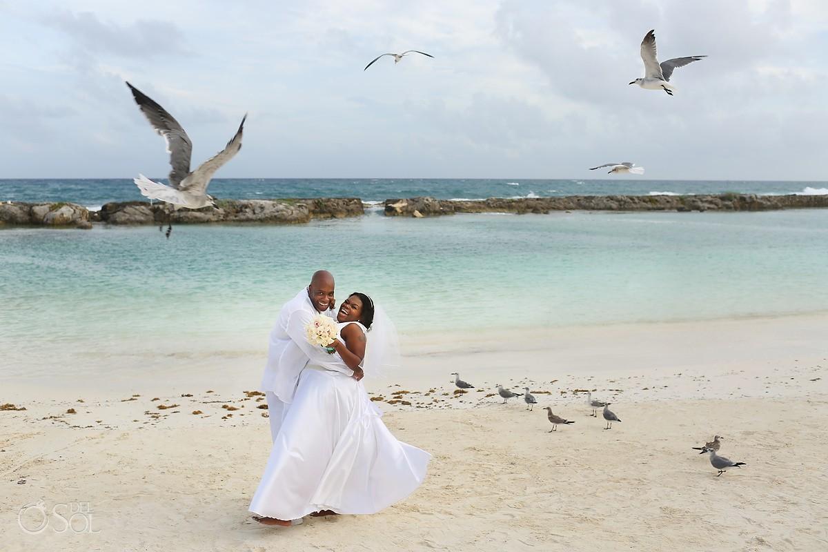 Destination wedding portrait flying birds seagulls Beach Hard Rock Riviera Maya