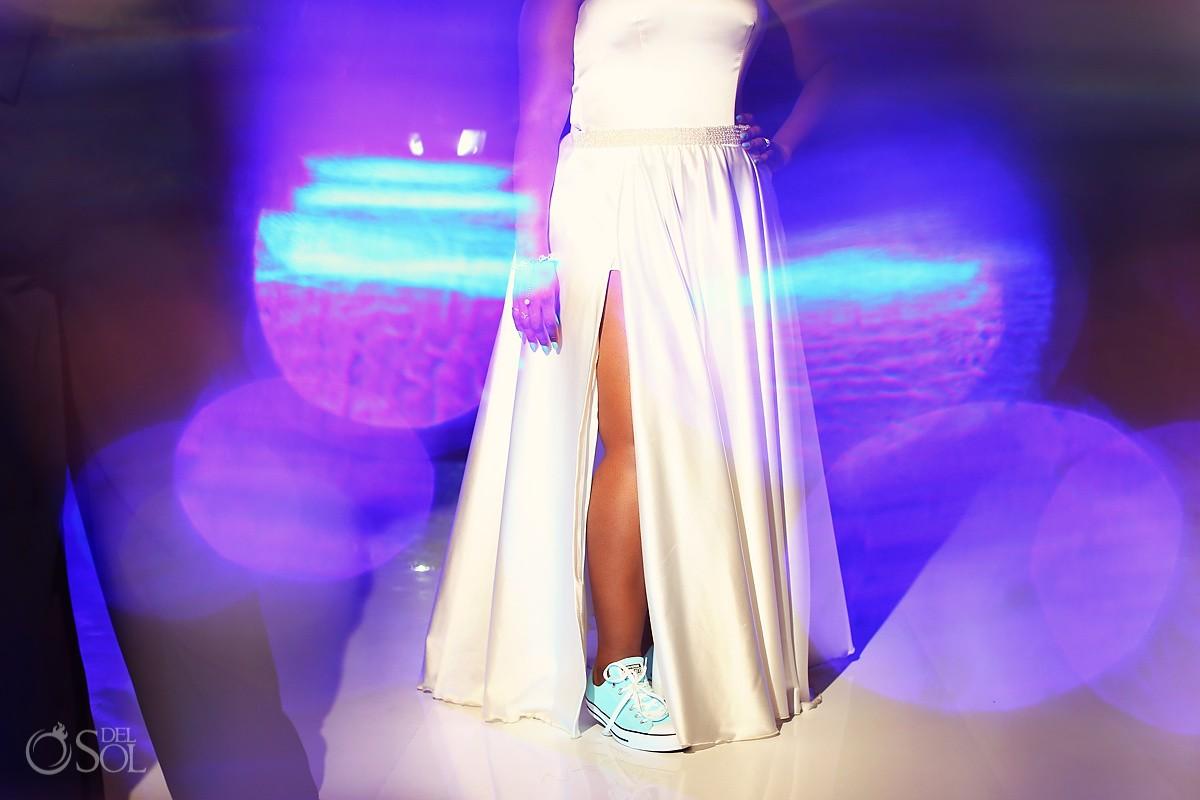 cool bride wearing sneakers with wedding dress destination wedding reception Hard Rock Riviera Maya