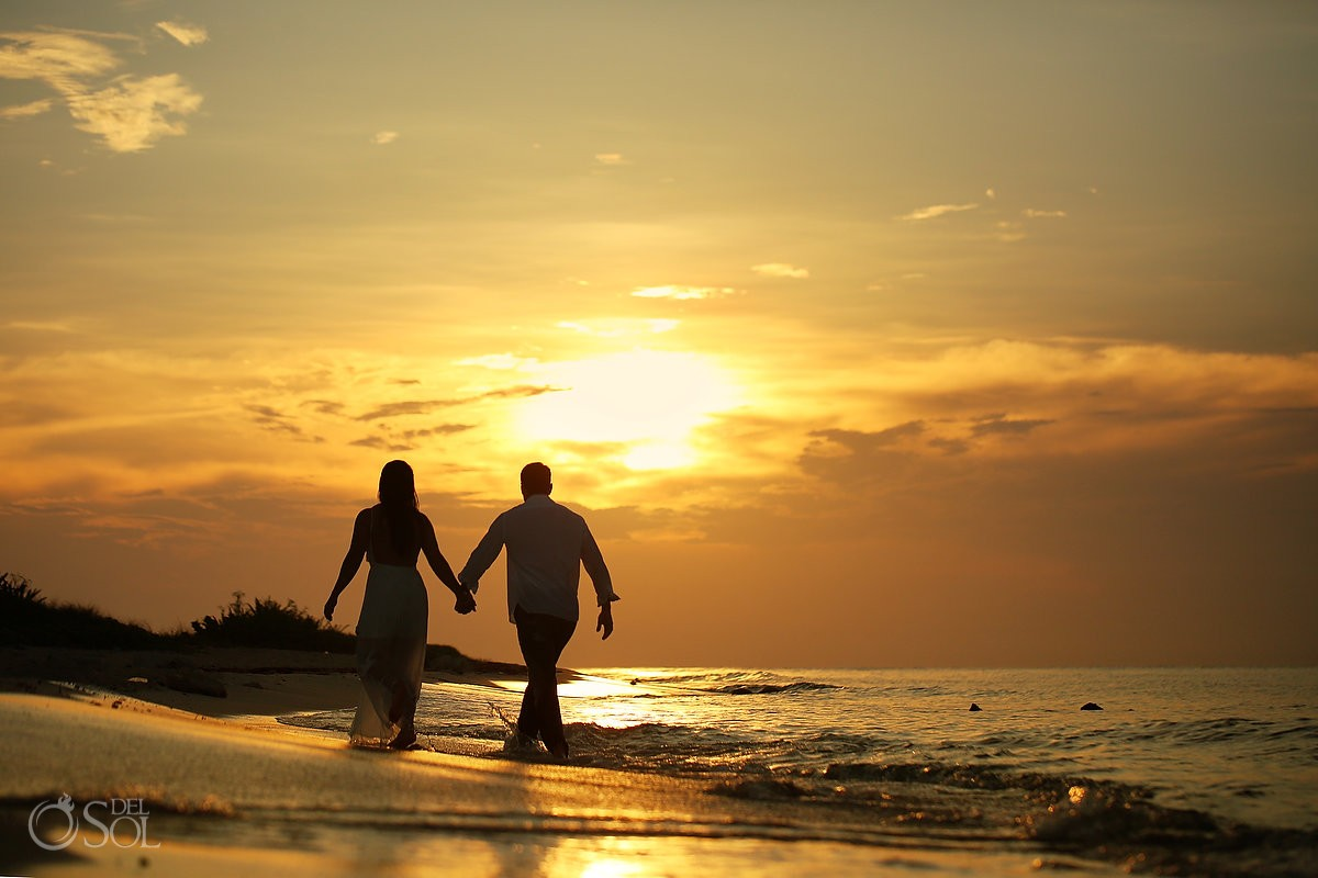 bride groom walking on the beach at sunrise, beach trash the dress wedding portrait Playa del Carmen, Mexico