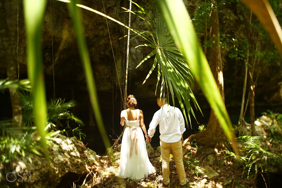 Bride groom walking jungle Riviera Maya Mexico