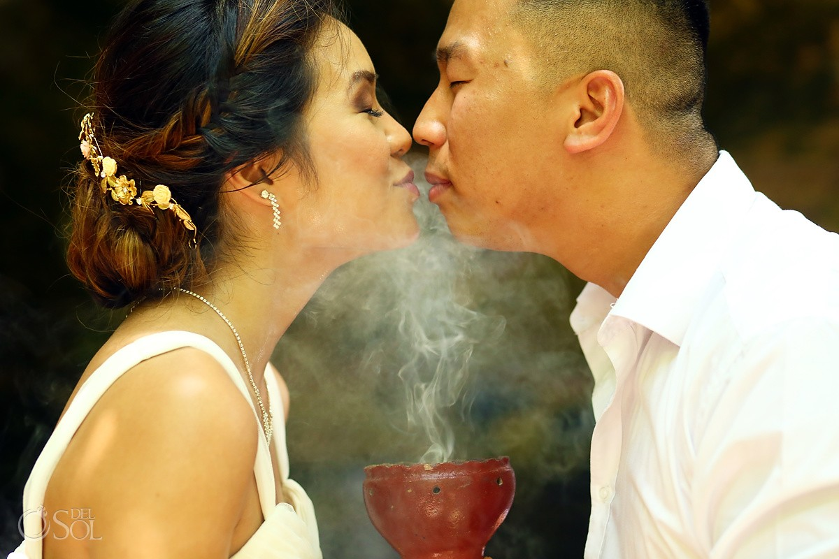Bride groom purifying soul with copal