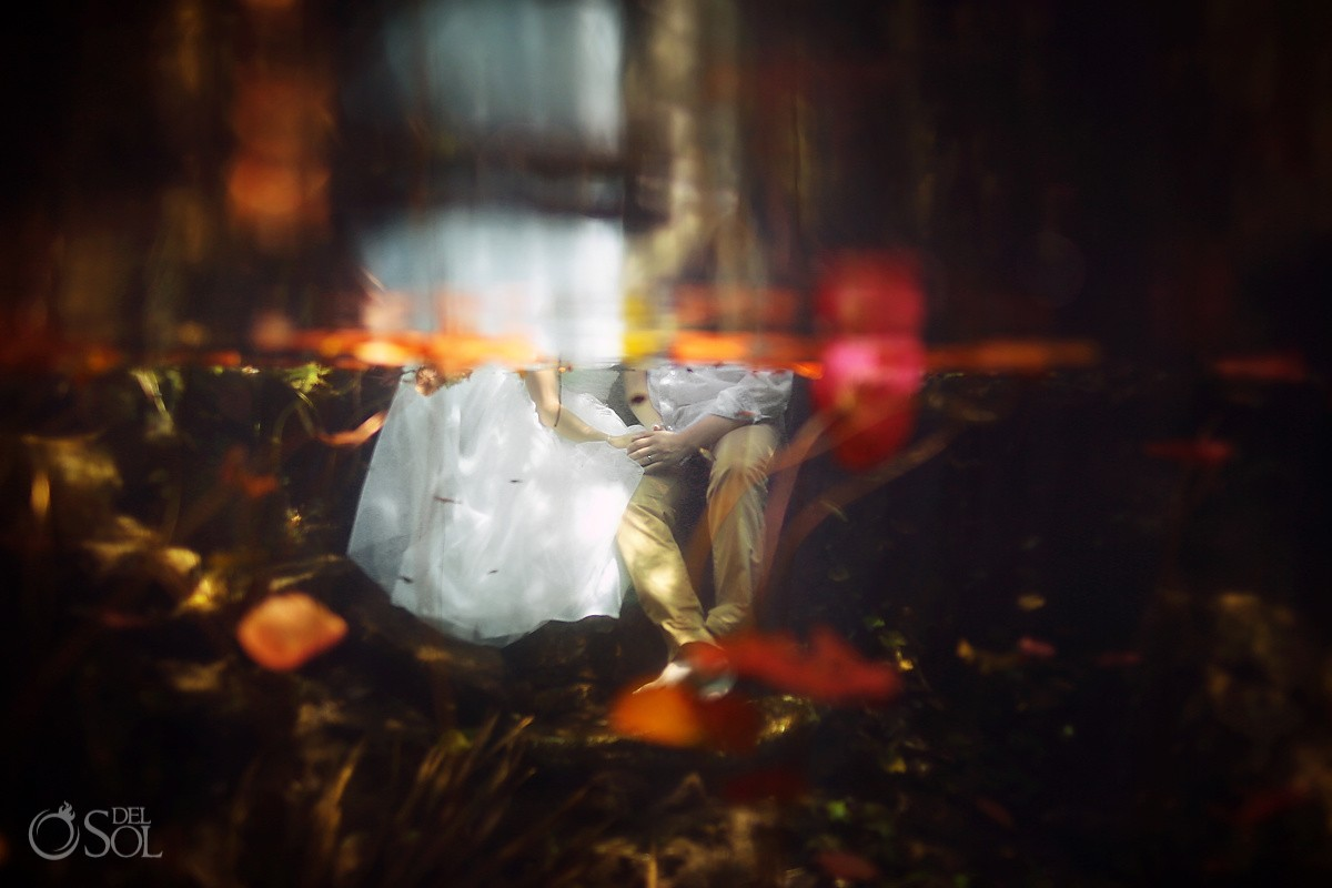 Artistic underwater bride groom cenote trash the dress