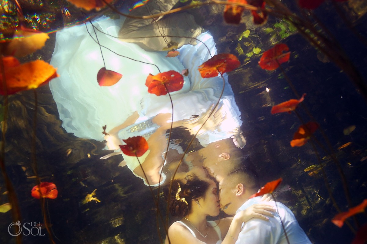 Romantic underwater bride groom kissing
