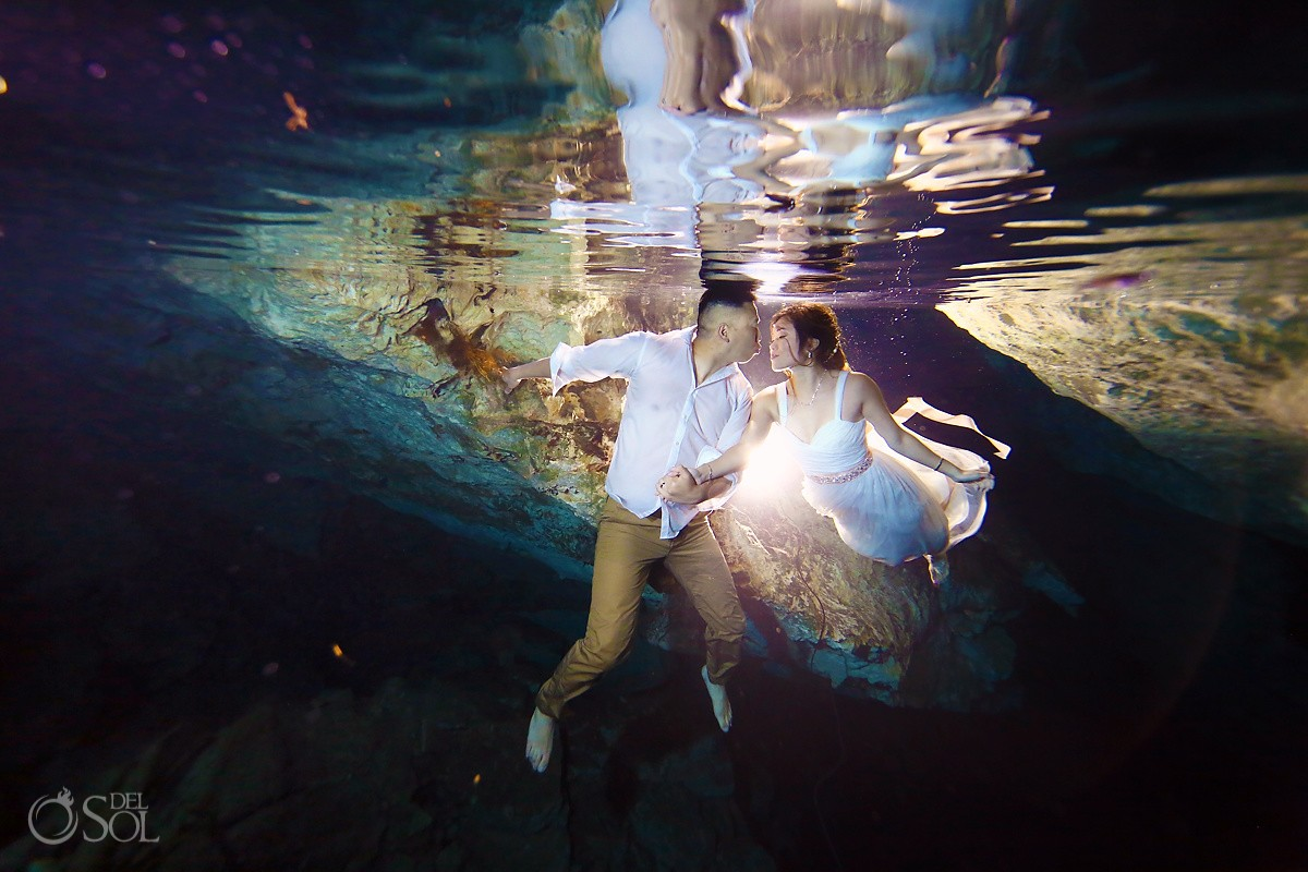 bride and groom underwater, cenote trash the dress Riviera Maya Mexico