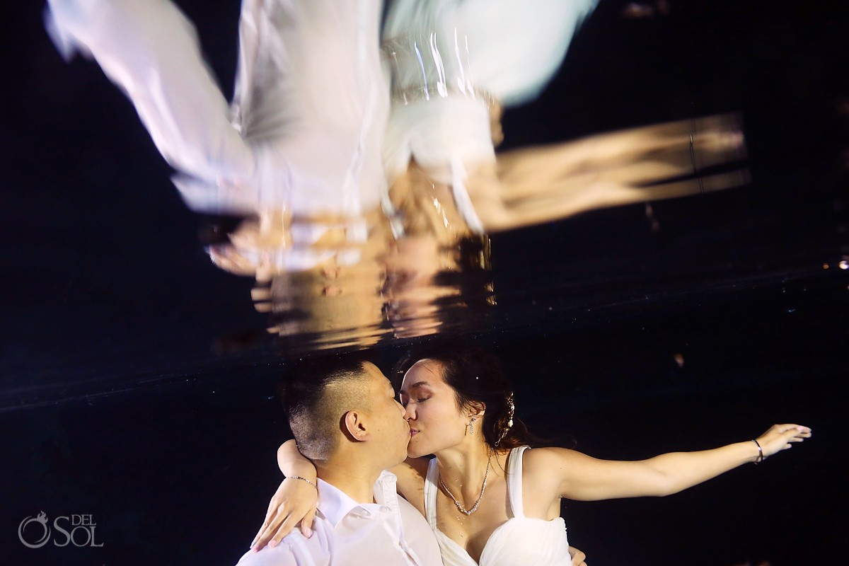 bride groom underwater kiss cenote trash the dress Riviera Maya Mexico