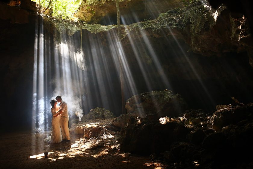 spectacular light rays wedding portrait cenote Aktun-Chen dry cave National geographic top 10 underground walks