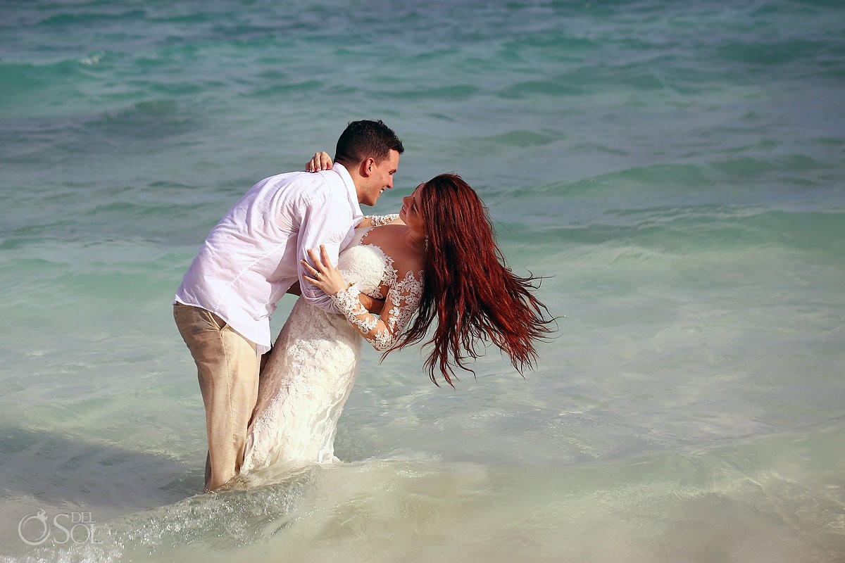 bride and groom in the caribbean ocean beach Trash the Dress Riviera Maya, Mexico