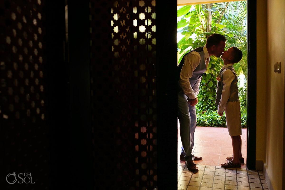 groom kisses son family love getting ready silhouette destination wedding Ocean Coral & Turquesa Gazebo