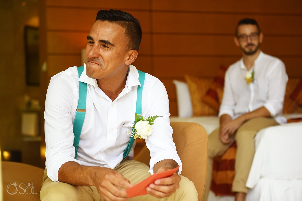 emotional groom crying reading wedding day gift letter getting ready Grand Sirenis Riviera Maya Mexico