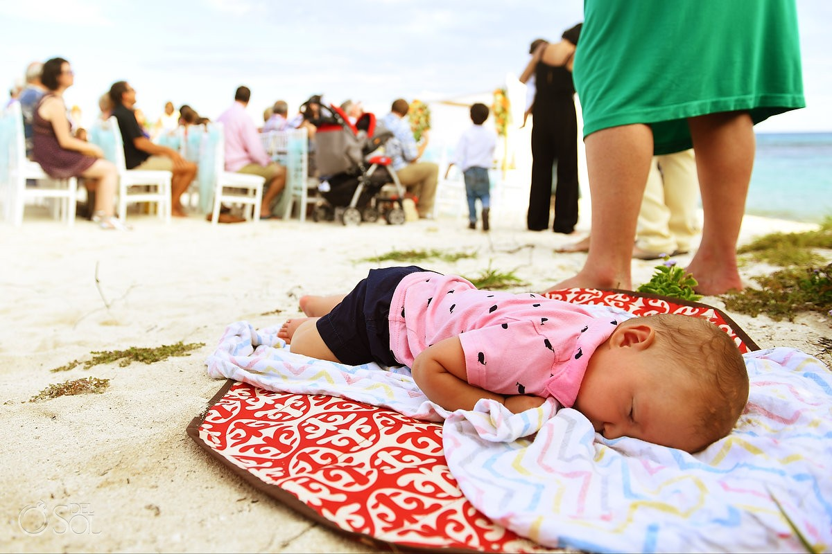 baby sleeping beside wedding ceremony beach destination wedding ceremony Grand Sirenis Riviera Maya Mexico