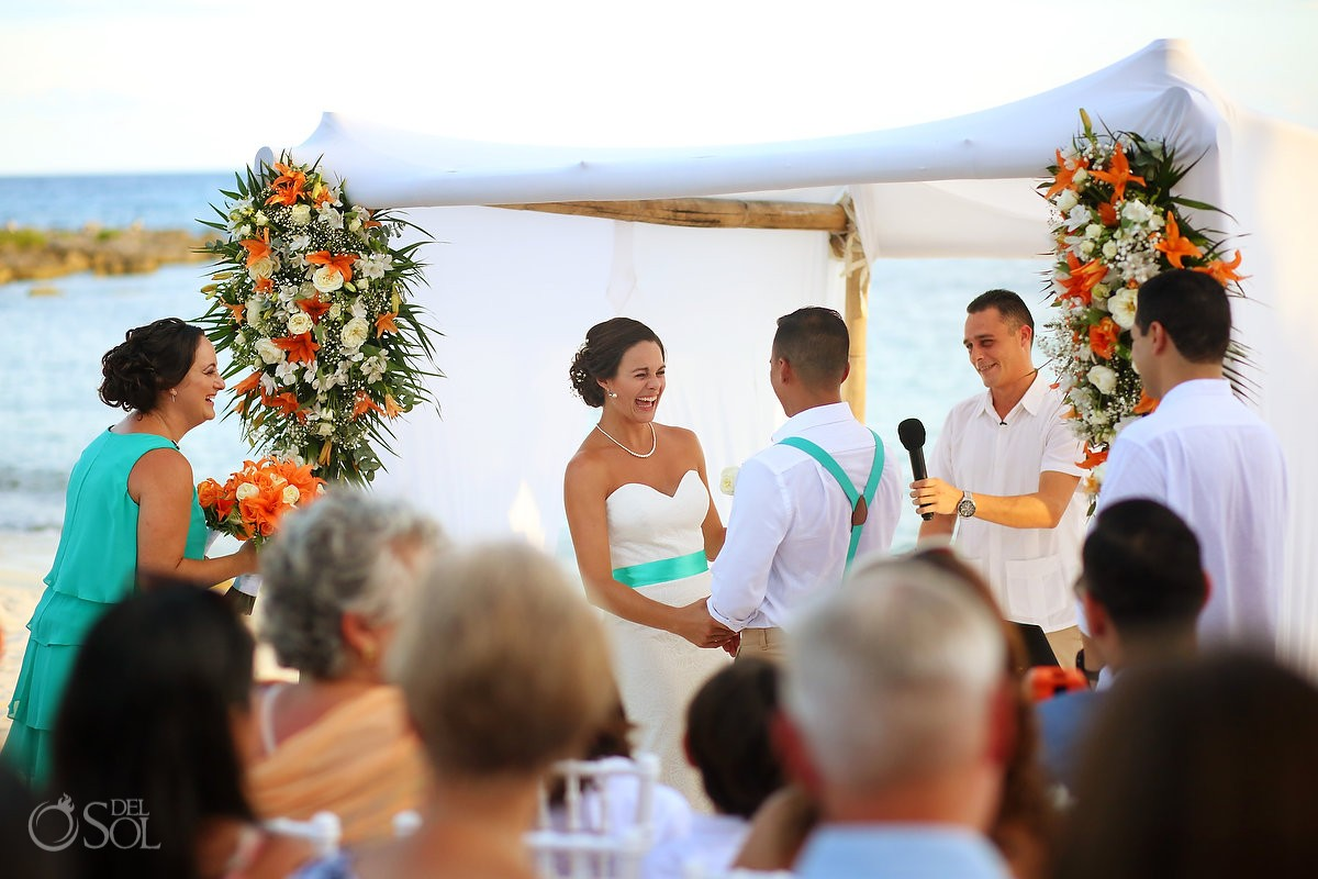 happy bride laughing beach destination wedding ceremony Grand Sirenis Riviera Maya Mexico